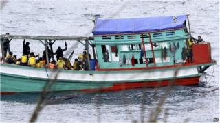 "File photo: a fishing boat carrying Vietnamese asylum seekers nears the shore of Australia""s Christmas Island on 14 April 2013"