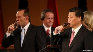 Chinese President Xi, Jinping right, and Australian PM Tony Abbott pledged to further boost bilateral ties