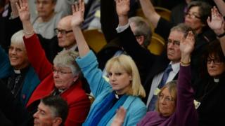 Women priests voting in the Anglican General Synod