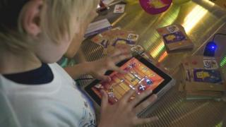 Kid playing a tablet