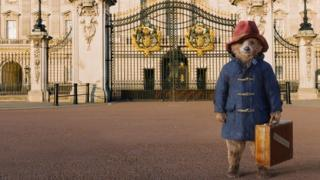 Paddington bear outside Buckingham Palace
