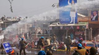 Indian police use batons and water cannon to disperse supporters