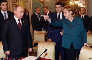 Germany's Merkel toughens tone with Russia's Putin