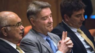 Brazilian businessman Eike Batista (centre) at the start of his trial on insider dealing. Photo: November 2014