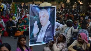 "Devotees of Indian self-styled ""godman"", Rampal Maharaj hold a poster of his image during a dharna - non-violent sit-in protest"