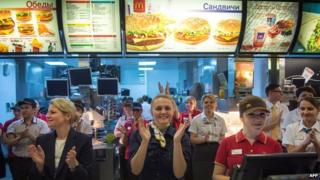 Staff at the Moscow McDonald's applaud its reopening