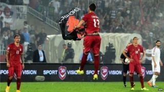 Serbian player Stefan Mitrovic pulls down the Albanian banner