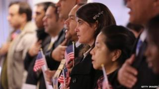 Immigrants take oath of citizenship to the United States on November 20, 2014 in Newark, New Jersey