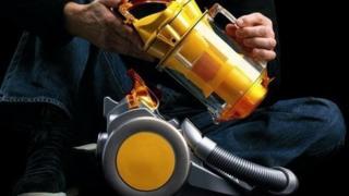 bagless vacuum cleaner being taken apart