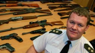 Dyfed-Powys Police Chief Inspector Ieuan Matthews with gun amnesty haul