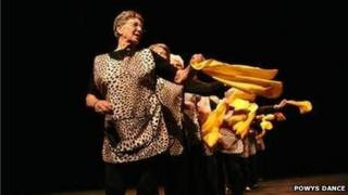 """Members of Powys Dance's Senior Moment(um) group perform their piece """"Dusters"""""""