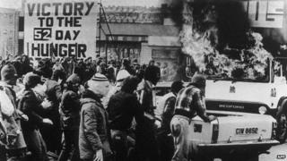 A group of young people sets fire on a van facing British troops in Belfast 22 April 1981