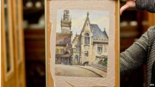 "The watercolour painting ""Altes Rathaus"" which was supposedly painted by Adolf Hitler, is shown at an auction house in Nuremberg, Germany, 20 November 2014"