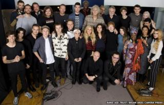 """Band Aid 30 artists recording a new version of the song Do They Know It?s Christmas?, to be released in order to raise money for charity, specifically the ebola crisis in west Africa, SARM Studios, Notting Hill, London, UK, 15.11.2014. the group line up.Top Row L-R: Kyle Simmons (Bastille), William Farquarson (Bastille), Guy Garvey (Elbow), Chris """"Woody"""" Wood (Bastille), Chris Martin, Dan Smith (Bastille), Seal, Sir Bob Geldof, Karl Hyde (Underworld), Roger Taylor, Joe Suggs (Thatcher Joe Youtube), Alfie Deyes (Youtube), Milan Neil Amin-Smith (Clean Bandit) and Grace Chatto (Clean Bandit) Second Row L-R Louis Tomlinson, Zayn Malik, Liam Payne, Niall Horan, Harry Styles, Olly Murs, Sinead O""""Connor, Ellie Goulding, Jessie Ware, Ed Sheeran, Zoella (Youtube), Angelique Kidjo, Emeli Sande, Paloma Faith.Front Row crouching L-R Midge Ure, Bono"""