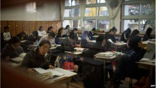 In a file photo taken on November 13, 2014, students sit the annual College Scholastic Ability Test, or college entrance exam, at the Poongmun high school in Seoul.