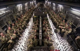 British military personnel in southern Afghanistan sitting patiently onboard a RAF C17 destined for the UK
