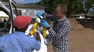BBC cameraman Al Candelin fixes a GoPro to a nurse's head
