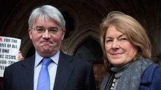 Andrew Mitchell and his wife Dr Sharon Bennett arrive at the High Court on 24 November