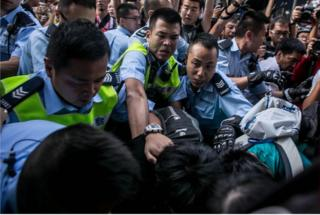 Police clash with protesters as they try to clear the street after agents authorized by bailiff's removed barricades on Argyle Street in Mongkok district on November 25. 2014