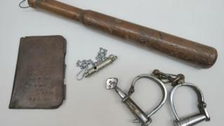 A notebook cover, truncheon, whistle and handcuffs that belonged to PC Edward Watkins