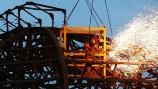Workers cut through girders on Eastbourne Pier