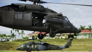 Colombian military helicopters take off to search for a general kidnapped by Farc rebels