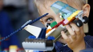 Child with lego