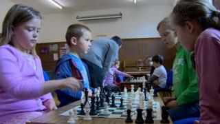 Russian children learning chess