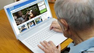 elderly man looking at NHS website