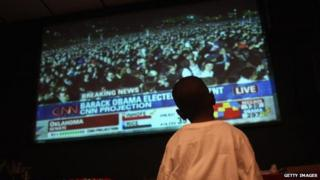 A young boy watches Obama's election night November 2008
