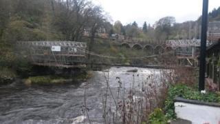 Scaffolding on chain bridge