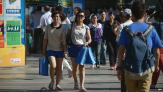 Shoppers on a street in Beijing