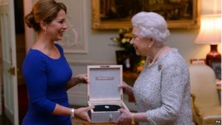 The Queen receiving a Federation Equestre Internationale award