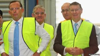 Australian Prime Minister Tony Abbott (L) and Premier of Victoria, Denis Napthine visit Backwell IXL in Geelong. 30 April 2014