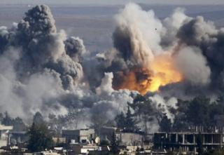 Smoke rises over Syrian town of Kobane after an air strike, as seen from the Mursitpinar border crossing on the Turkish-Syrian border in the town of Suruc in this file October 18, 2014 file photo