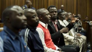 Men from Democratic Republic of Congo (DRC) accused of seeking to assassinate DRC President Joseph Kabila sit at the dock on August 4, 2014