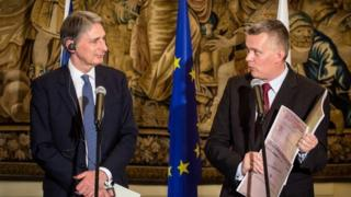 Foreign Secretary Philip Hammond (L) and Polish Defence Minister Tomasz Siemoniak (R) address a joint press-conference in Warsaw, Poland on July 28, 2014