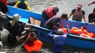 File photo: Rescuers assist survivors arriving on fishing boat at the wharf of Cidaun, West Java, after an Australia-bound boat carrying asylum-seekers sank off the Indonesian coast, 24 July 2013