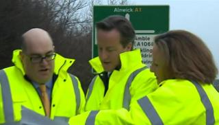 Prime minister David Cameron, centre, with Highways Agency staff in Northumberland