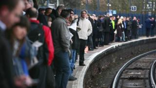 Passengers waiting at London Bridge station