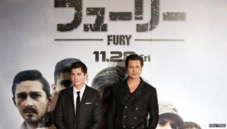 "Cast members Brad Pitt (R) and Logan Lerman pose for pictures on the red carpet for the Japan premiere of the movie ""Fury"" in Tokyo"