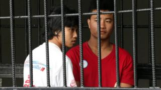 Win Zaw Htun (L) and Zaw Lin in a jail cell