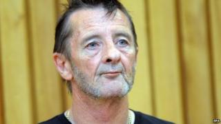 AC/DC drummer Phil Rudd appears in the High Court for charges of drug posession and threatening to kill, at the District Court in Tauranga, New Zealand, 26 November 2014