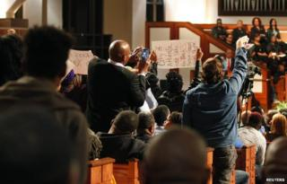 "Protesters disrupt speech in Ebenezer Baptist Church during a forum titled ""The Community Speaks"" in Atlanta, Georgia December 1, 2014"