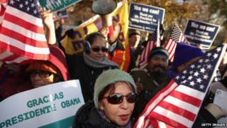 About 100 people gather to rally in support of President Barack Obama's executive action on immigration policy in Lafayette Square across from the White House 21 November 2014
