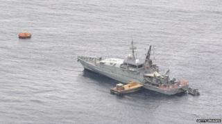 RAN Armidale Class Patrol vessel HMAS Bathurst takes on supplies at Flying Fish Cove on July 27, 2013 in Christmas Island, Indian Ocean Territories, Australia