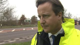 David Cameron standing by the A47 in Norfolk