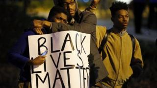 Protesters take part in a protest over the shooting death of Michael Brown in Webster Grove, Missouri