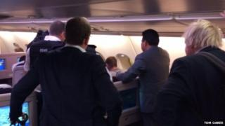 Boris Johnson and police onboard a plane