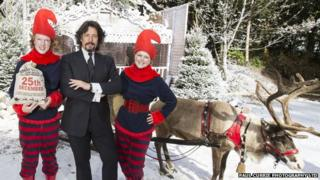 Laurence Llewelyn-Bowen posing with elves at the Magical Journey